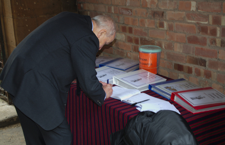 Frank Field signing the visitors book